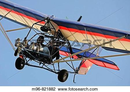 Stock Photo of Ultralight aircraft coming in for landing.