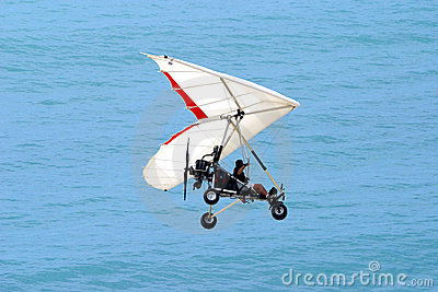 Ultralight Flying Coming In For A Landing On The Beach Royalty.