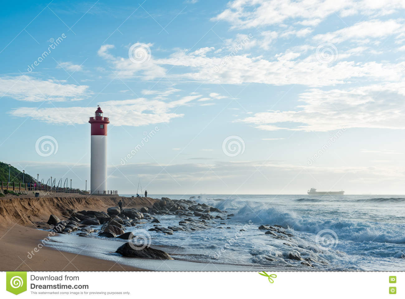 Umhlanga Rocks Lighthouse With Fishermen And People Walking On The.