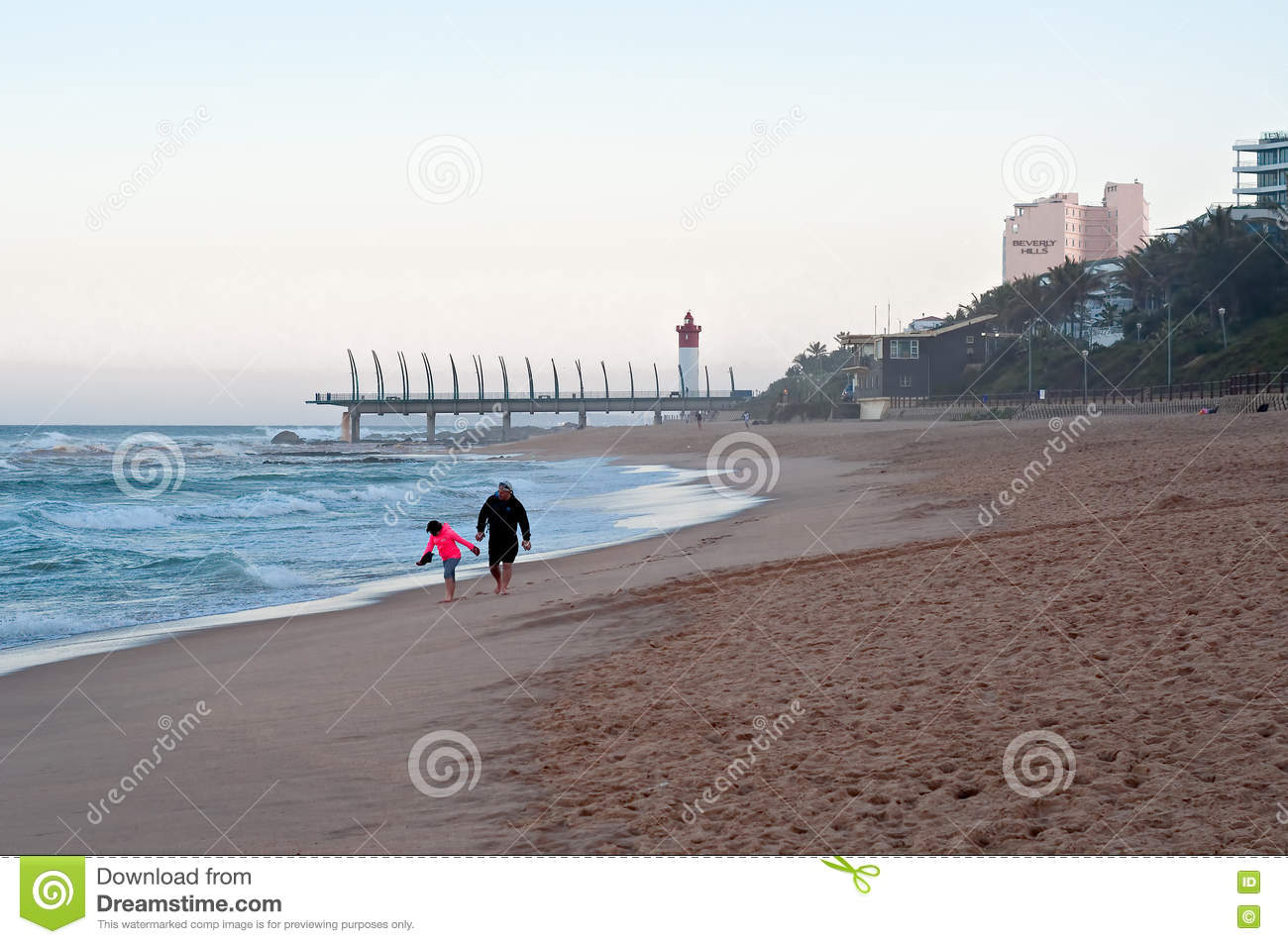 People On The Beach At Umhlanga Rocks, With The Millennium Pier.