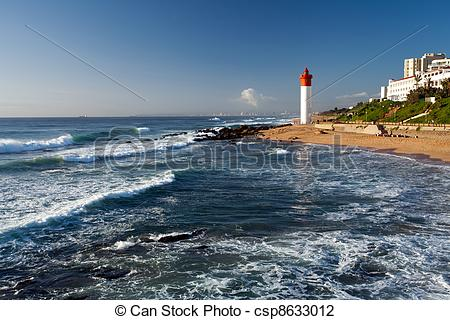 Stock Photo of lighthouse in morning sunlight in Umhlanga beach.