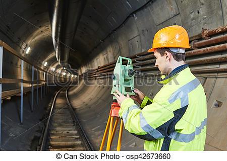 Stock Image of Surveyor with theodolite level at underground.