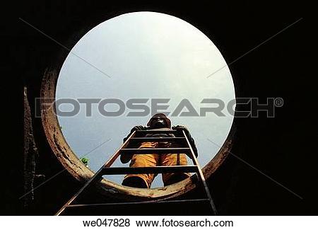 Pictures of Telephone Company employee. Underground work. we047828.