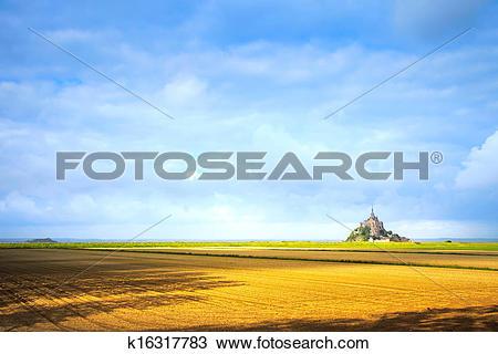 Stock Photo of Mont Saint Michel monastery landmark and field.