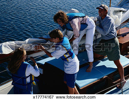 Picture of Family Unfurling a Sail on a Sailboat x17774167.
