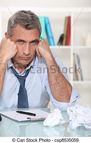 Stock Photographs of uninspired writer amid paper balls csp8535059.