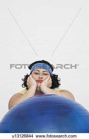 Stock Photo of Uninspired overweight Woman Resting on Exercise.