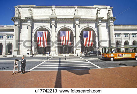 Stock Photo of American flags fly at Union Station, Washington, DC.
