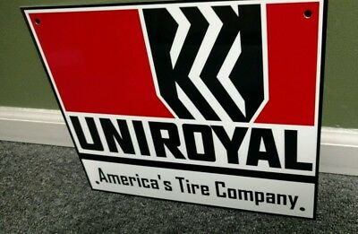 UNIROYAL TIRE TIRES sign.
