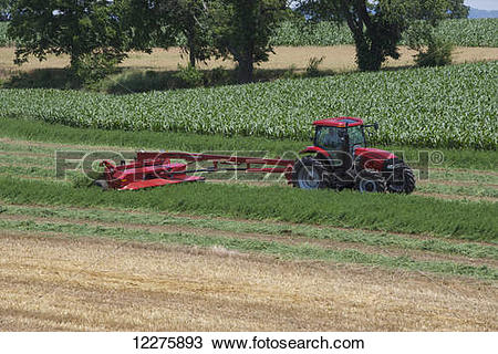 Stock Photo of Case IH Tractor with DC132 Disc Mower cutting.