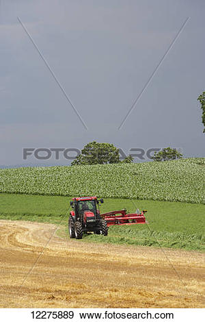 Stock Photograph of Case IH Tractor with DC132 Disc Mower cutting.