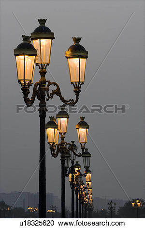 Stock Photography of Sharjah UAE Lampposts glowing just after dark.