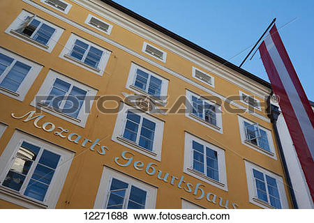 Pictures of The house where Mozart was born with an Austrian flag.