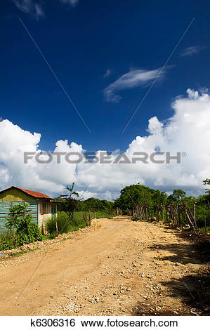 Stock Illustration of Unmade earth road in a village Dominican.