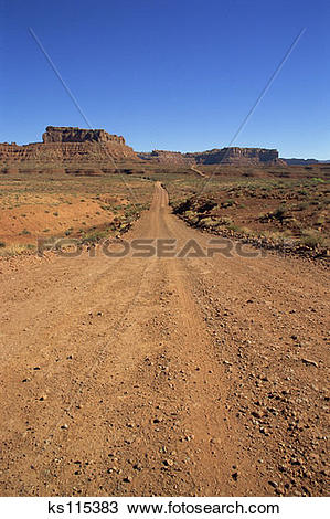 Stock Photo of Unpaved road passing through Valley of the Gods, UT.