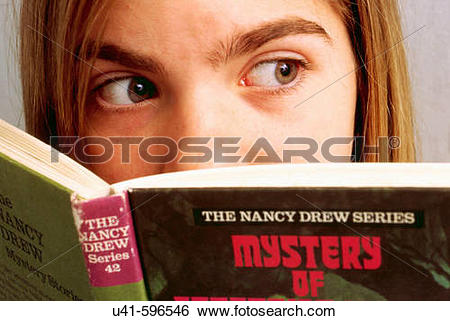 Stock Images of Reading a scary book,12 year old school girl.