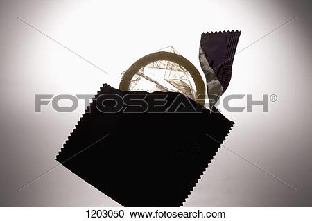 Stock Photography of An opened condom wrapper with an unused.