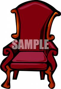 An Antique Wing Back Chair With Red Upholstery.