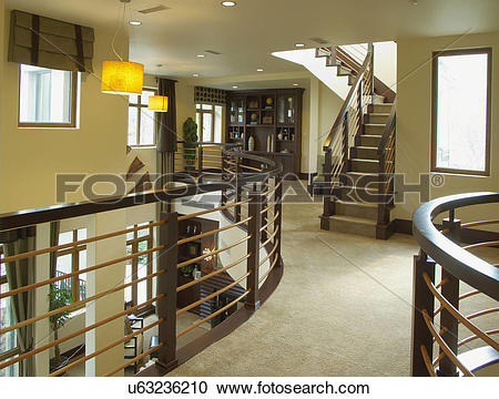 Stock Photography of Brown railings and steps on upper floor in.