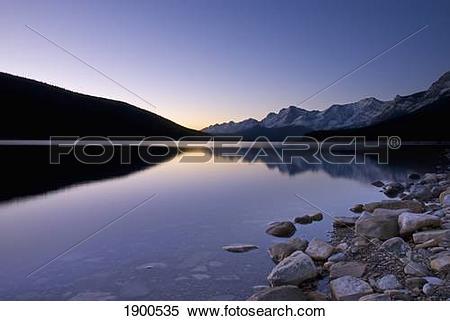 Stock Image of sunrise on the upper lake of kananaskis; alberta.