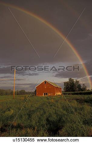 Stock Image of rainbow, Upstate, barn, New York, Rainbow over a.