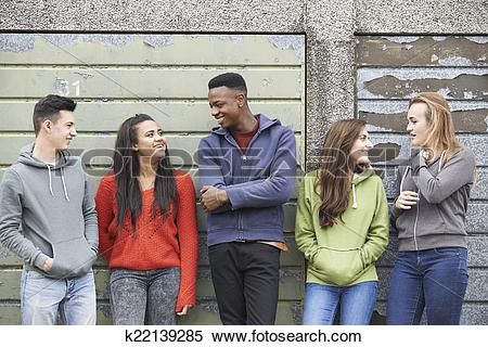 Stock Image of Gang Of Teenagers Hanging Out In Urban Environment.