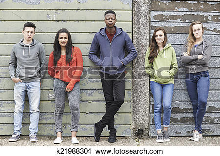 Stock Photo of Gang Of Teenagers Hanging Out In Urban Environment.