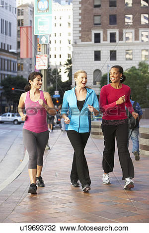 Stock Photo of Group Of Women Power Walking On Urban Street.