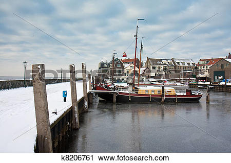 Clipart of Harbor of Dutch fishery village Urk in wintertime.