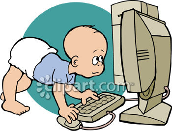 A Baby Using A Computer.