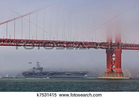 Stock Image of Aircraft carrier USS Carl Vinson passes under the.