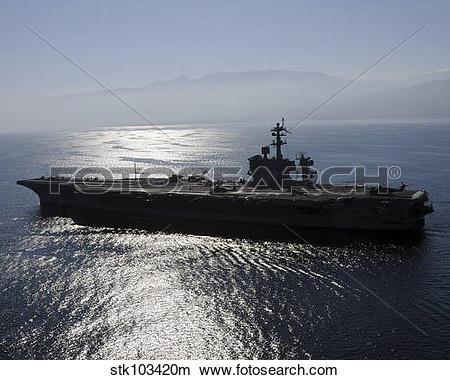 Stock Photo of Aircraft carrier USS Carl Vinson awaits the return.