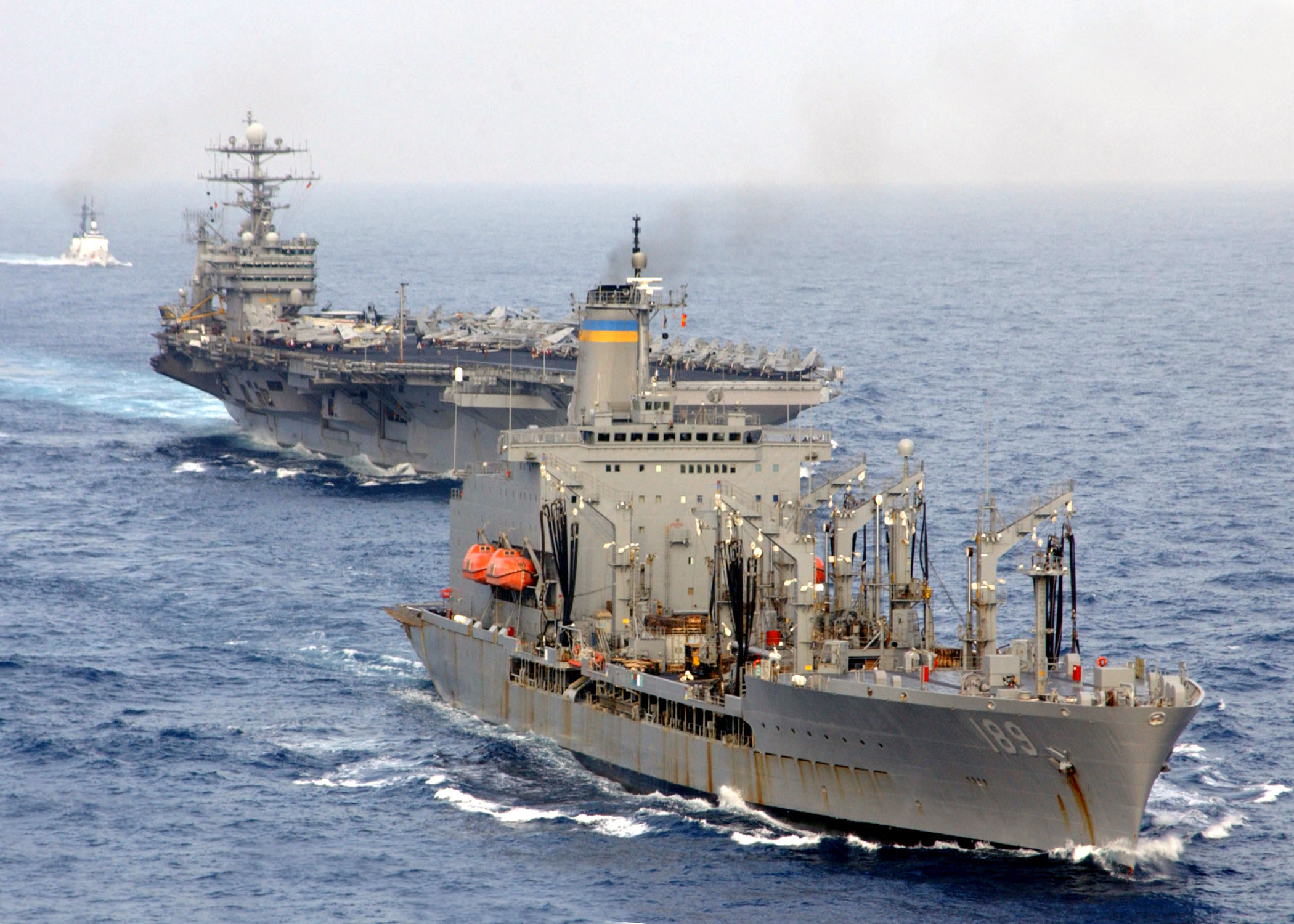 Uss Harry S. Truman (cvn 75) Comes Alongside The Military Sealift.