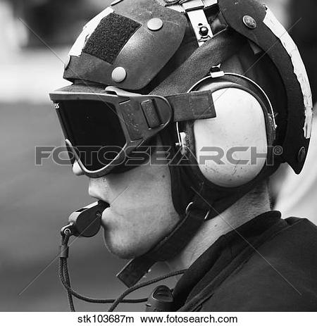 Stock Photo of A Sailor supervises flight operations aboard the.