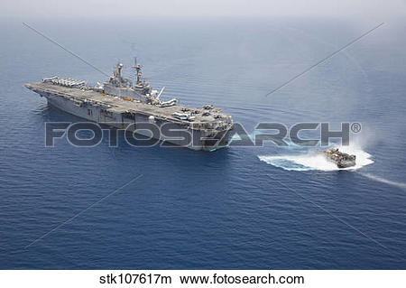 Stock Photo of A landing craft air cushion approaches the well.