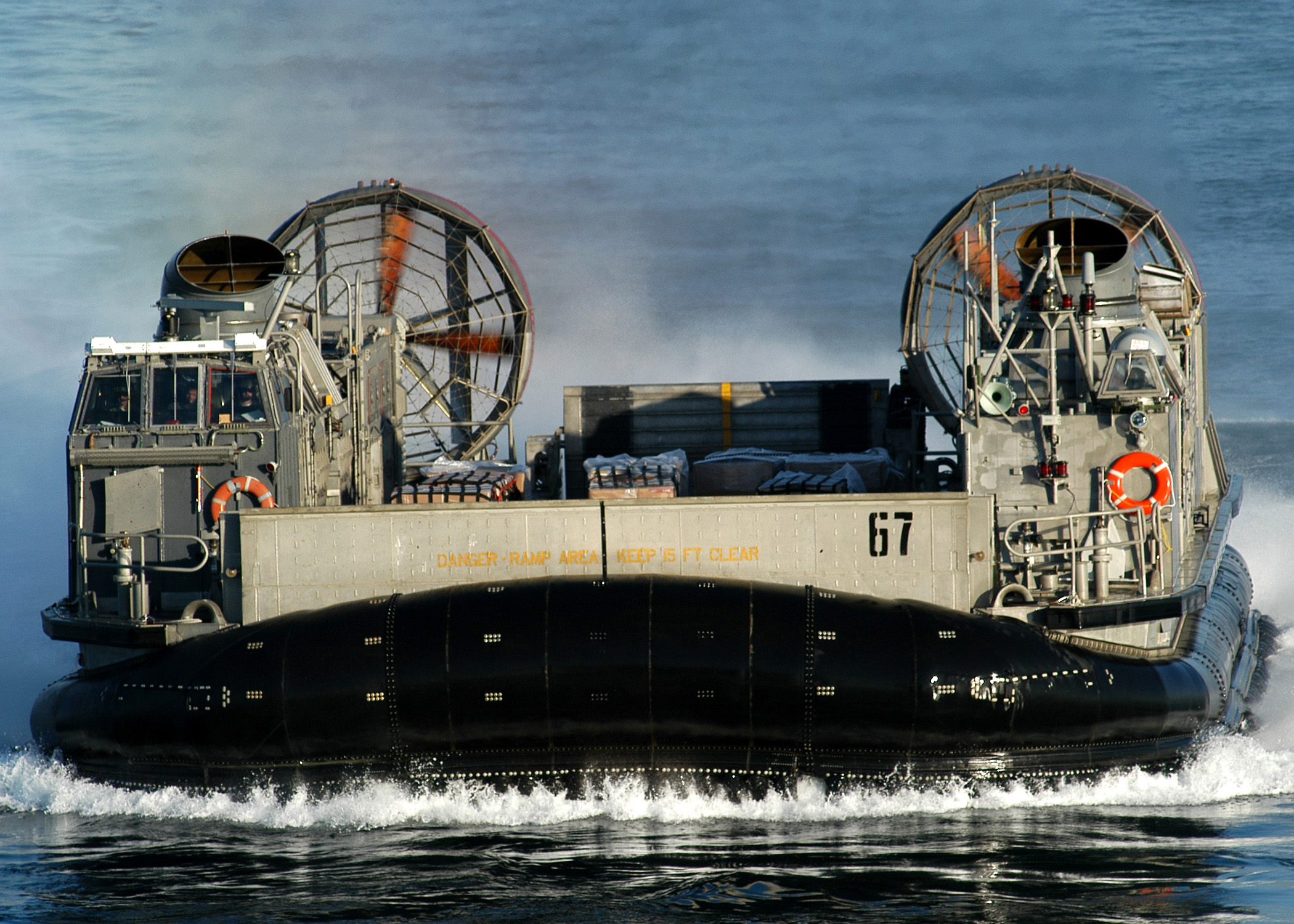 A Landing Craft Air Cushion (lcac) Craft On Approach To The.