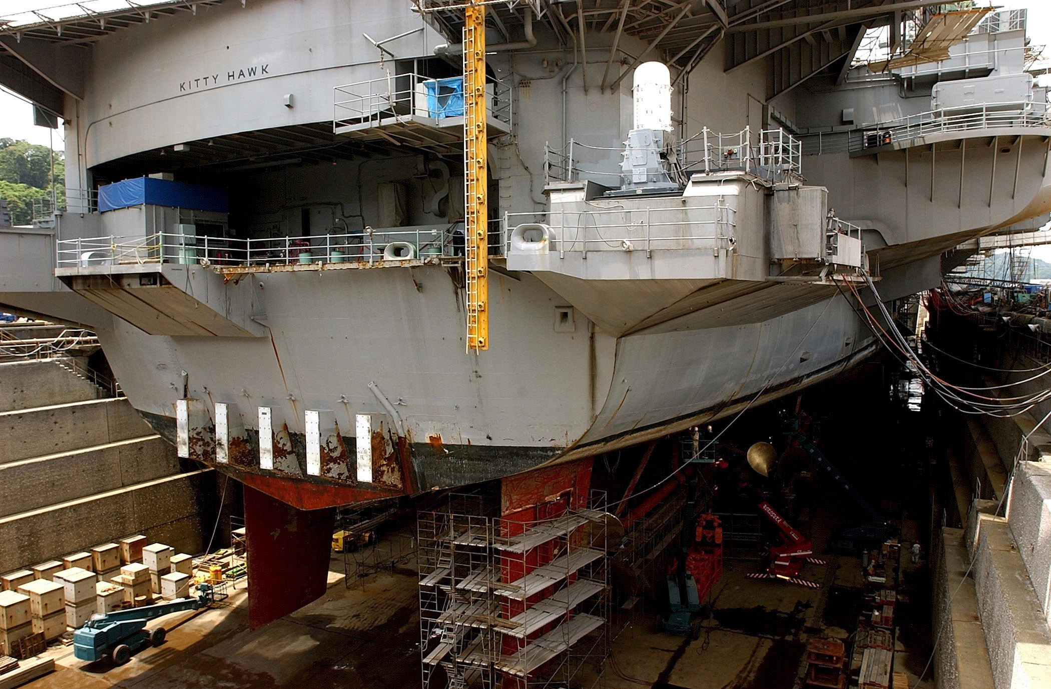 Uss Kitty Hawk (cv 63) Sits In Dry Dock Undergoing Repairs At.