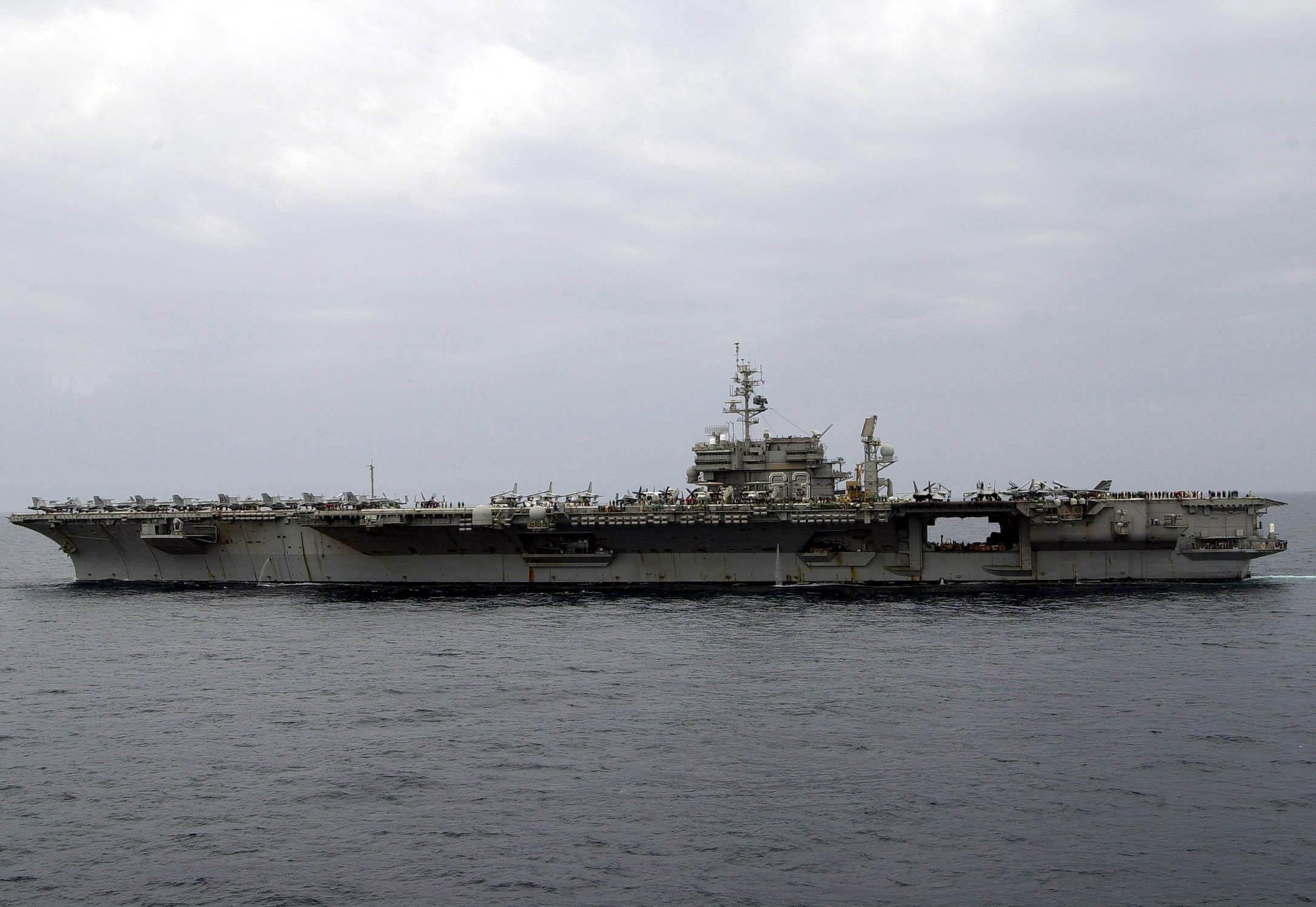 Uss Kitty Hawk (cv 63) Steams In The Arabian Gulf As It Heads.
