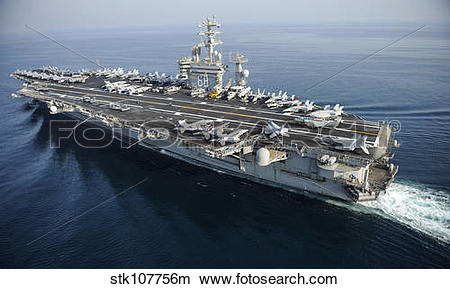 Stock Photo of The aircraft carrier USS Nimitz is underway in the.
