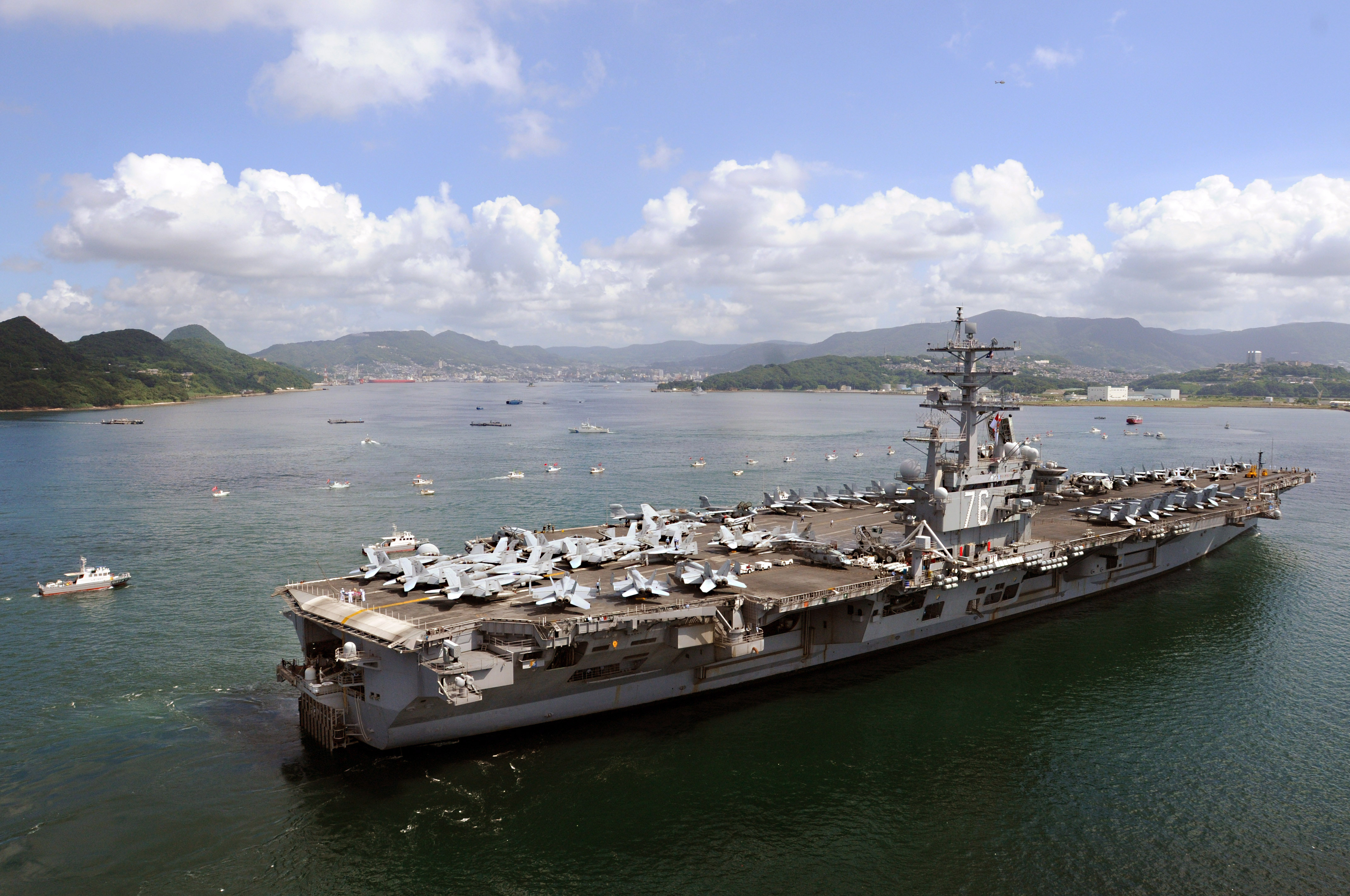 USS Ronald Reagan and Other Small Boats in a Stock Photo.