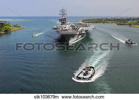Stock Photo of Aircraft carrier USS Ronald Reagan transits Pearl.