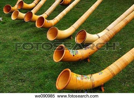 Stock Image of Swiss Alphorns at a Swiss folk festival, Valais.