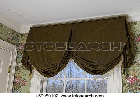 Stock Photo of WINDOW TREATMENTS: dark olive brown valance with.
