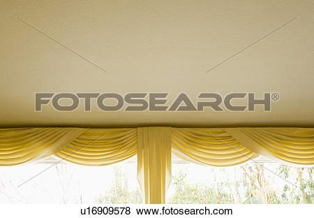 Pictures of Yellow Valance and Curtains on Window u16909578.
