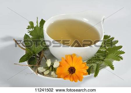 Stock Photo of A cup of herbal tea with marigold, dead.
