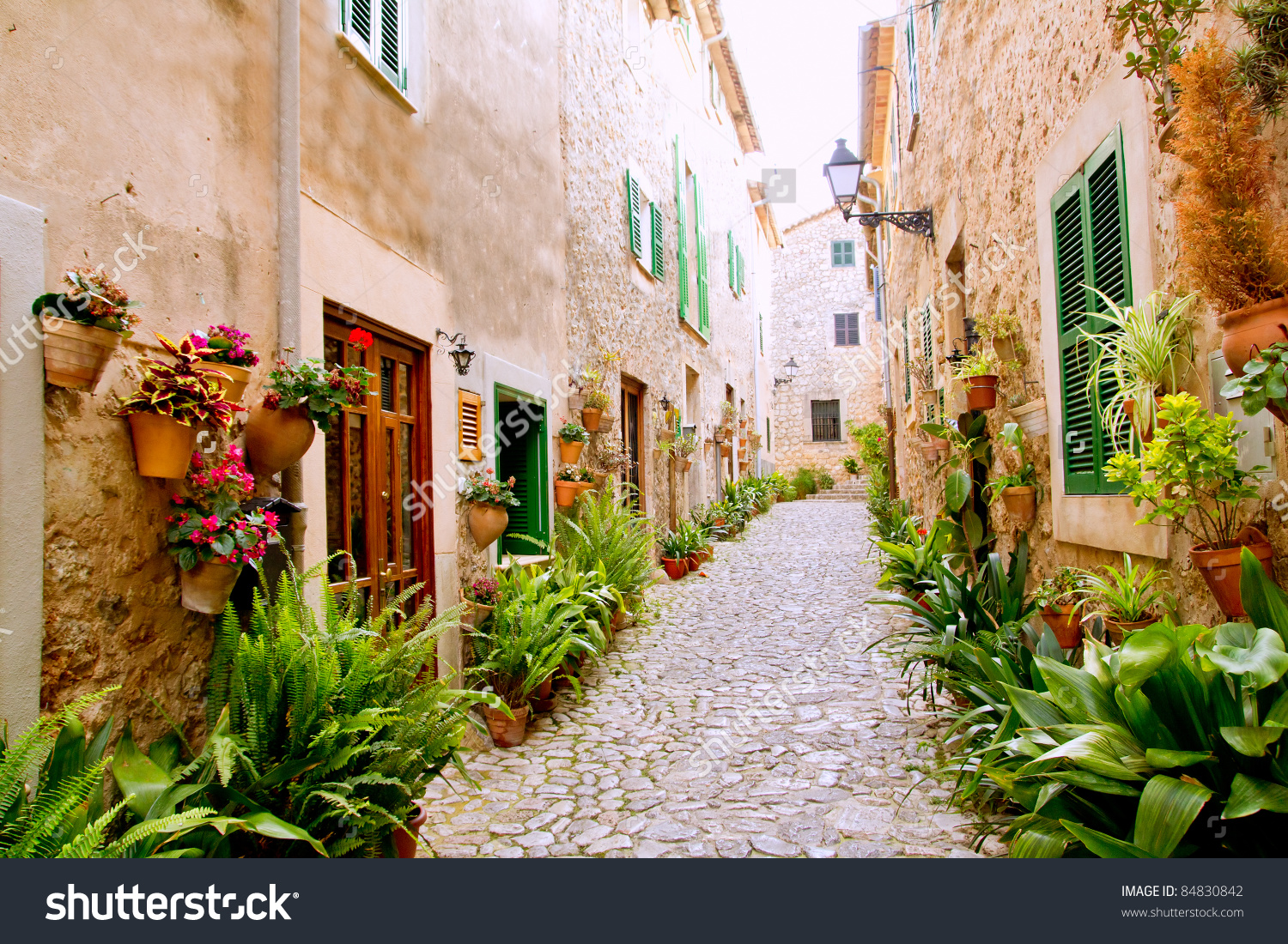 Majorca Valldemossa Typical Village With Flower Pots In Facades At.