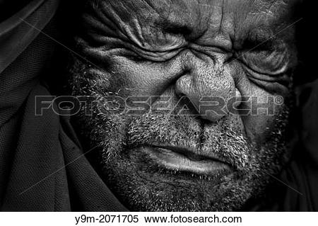 Stock Image of A Colombian peasant painfully struggles during a.