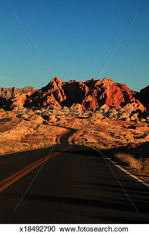 Stock Photography of Lonely road in Valley of Fire, Nevada.