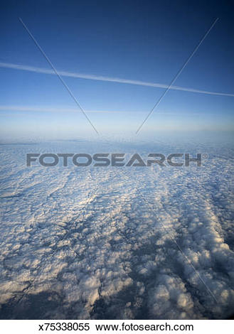 Stock Image of Clouds and vapor trails in upper atmosphere.