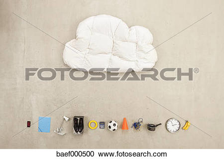 Stock Photography of Cloud shape pillow with variety of items on.
